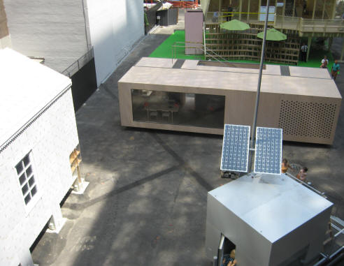 Looking down at exhibit lot from Cellophane House; New Orleans on left; Micro House on right; System 3 in middle; Burst House upper right.