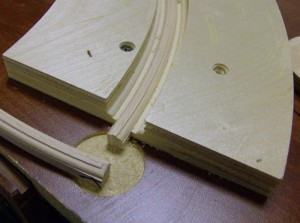 The same setup holds the pieces while a profile bit follows the curve.