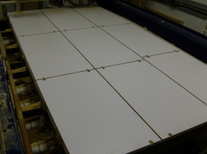A few minutes ago this was a full intact sheet of white melamine. Now it's a stack of parts ready to be edgebanded.