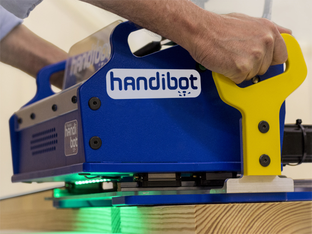 It's an app-driven power tool. It's a portable 3D cutter. It's the Handibot!