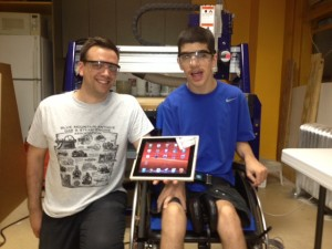 DIYAbility's co-founder John Schimmel with Matthew Eltan show off the finished iPad holder that Matthew designed and built