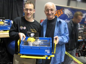 Chris Thompson introduced the Handibot Tool to Woodie Flowers (right), MIT engineer and co-founder with Dean Kamen of FIRST Robotics