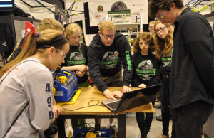 Paul Suplee and Team Titanium Wrecks demonstrate the Handibot Smart Tool at FIRST Robotics Competition