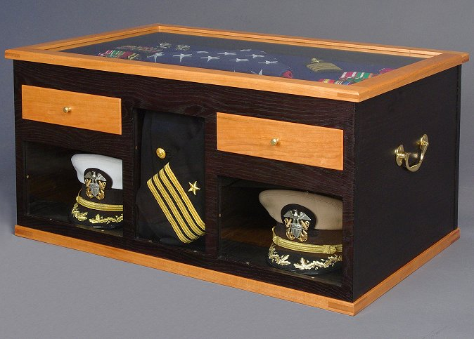 "Officer's Sea Chest and Shadow Box. Materials: cherry, white oak, red cedar, holly. Ebonized oak with shellac polish finish. Brass hardware. 16""H x 32""W x 20""D"