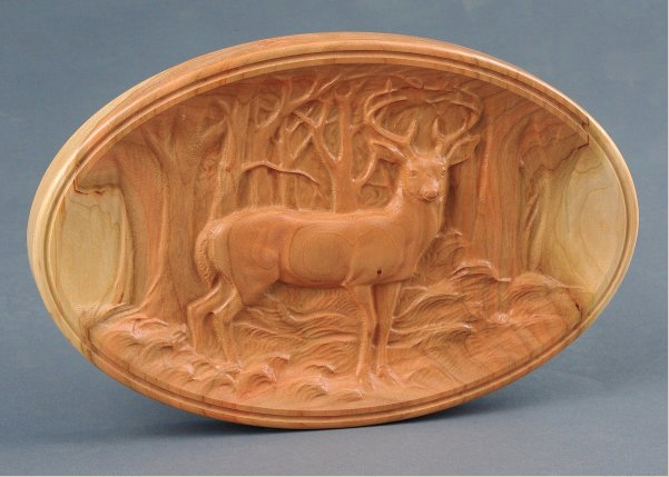The Deer in the Forest. This piece is individually carved to order on hardwood by a computer numerical controlled (CNC) routing machine, touched up with hand carving gouges, sanded, then finished.
