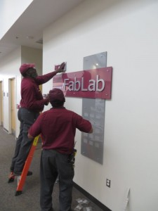 putting up sign