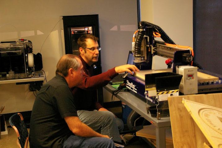 PPLD's Dan Raffin assists a patron with the use of their ShopBot Desktop