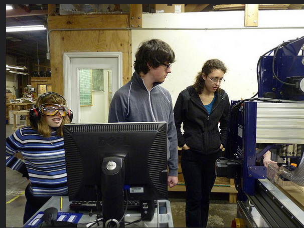 Lauren helps other students run the ShopBot