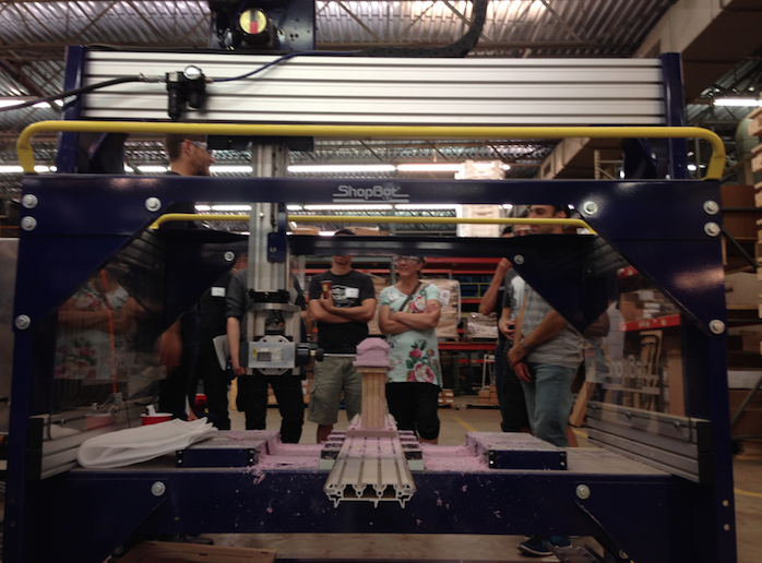 Visitors get a demo of the 5-Axis CNC from Nate Zellmer