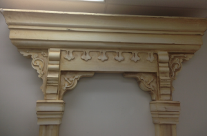 """The arch was used in a production of Summer and Smoke. It is made out of MDF and white pine, and the cornice is made from white bead foam we had custom cut. The curl detail was cut on the ShopBot."""