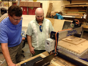 ShopBot's Randy Johnson assists a student with the ShopBot Desktop.