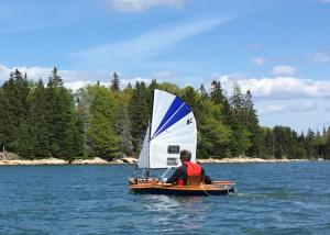 wooden kayak sailing