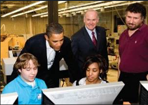 US President Obama, College President Dr. Roy A. Church, and Fab Lab Director Prof. Scott Zitek, work with 10th grade geometry students.