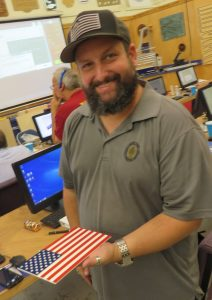 smiling man holding digital fabrication american flag