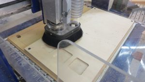 Shopbot CNC router pocketing a wooden board