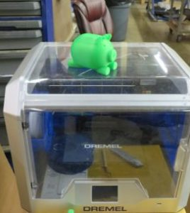 green pig on top of 3d printer