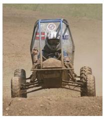 custom car driving in the dirt