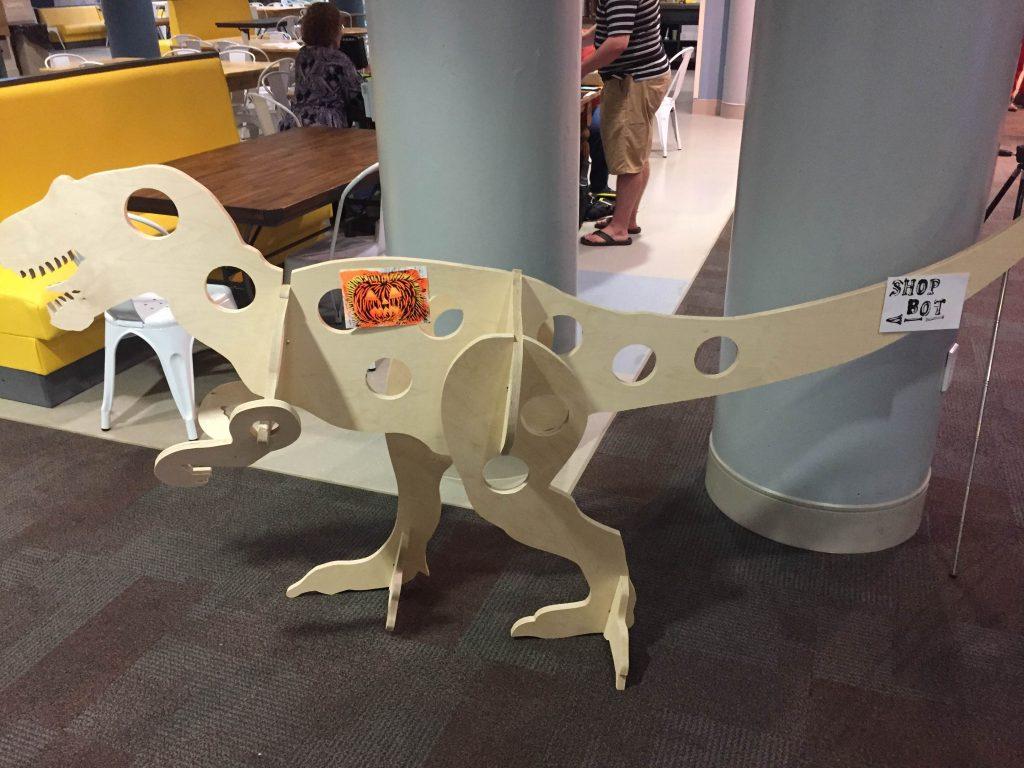 wooden t. rex at mini maker faire