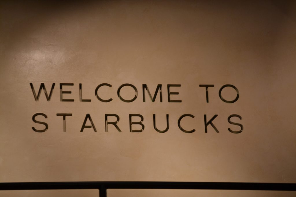 welcome to starbucks carved into wall