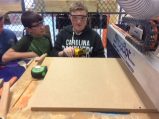 Rosman students looking at ShopBot