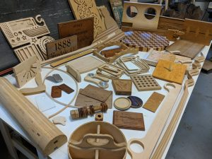 Several dozen pieces, parts and projects of various nature, all custom designed and cut with a ShopBot CNC machine