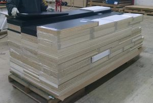 Stack of wrapped parts on a large pallet getting ready to be shipped out