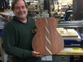 Chris Burns showing off inlay work on a Martin Guitar done with the help of a ShopBot